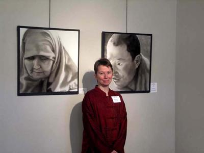 Installation photograph of Barbara Stout with two of her portraits, Seattle, WA